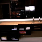 Custom Floating Shelves Wood: Fiddle Back Maple top, walnut ebonized  Joinery: Custom carved drawer pulls, Fiddle Back Maple Drawer Box Finish: Stain black Shelves and Hand Rubbed Oil on Shelves and Top