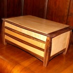 "Medium Size Jewelry Box - Two drawers and lift up top Wood: Fiddle Back Maple - Walnut trim Size: 6 3/4"" Tall x 14"" Wide x 9 1/4"" Deep Finish: Clear oil hand rubbed"