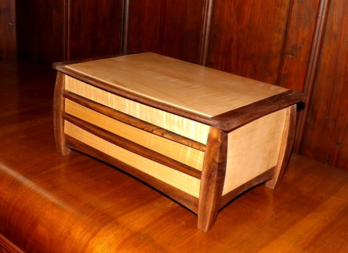 """Medium Size Jewelry Box - Two drawers and lift up top Wood: Fiddle Back Maple - Walnut trim Size: 6 3/4"""" Tall x 14"""" Wide x 9 1/4"""" Deep Finish: Clear oil hand rubbed"""