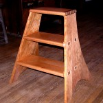 Curly Cheery Library Step Stool Wood: Curly Cheery, Birdseye Maple Joinery: Through Mortise and Tenon bottom step Dove Tail top step with inlays Finish: Clear Hand Rubbed Oil