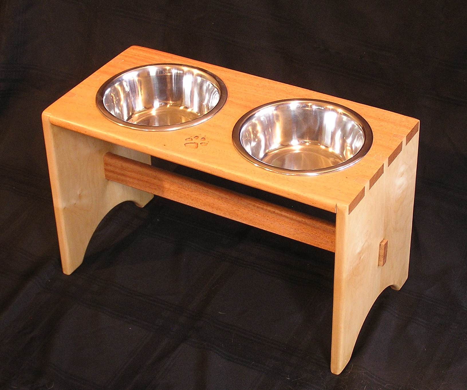 Dog Bowl Wood: Mahogany, Maple Joinery: Dovetail- wedged through mortise and tenon - carve foot Print I build this for a auction raising money for animal treatment.