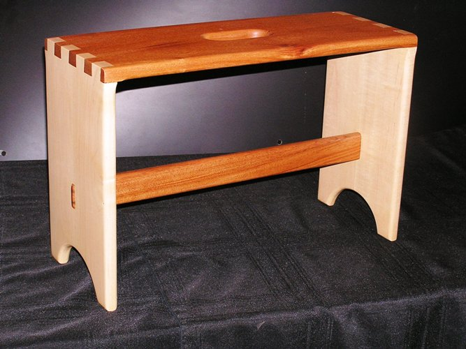 """Custom small Bench were only on step is needed Wood: Maple and Mahogany Joinery: Dovetail top and through Morten's an Tenon  Size: 22 1/2"""" wide x 14 3/4"""" tall x 8 5/8"""" deep"""