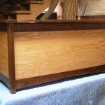 "Hope Chest  wood: red oak, walnut Through mortsen and tenon finish: clear hand rubbed size 24"" wide x 24"" deep x 48"" lonf"