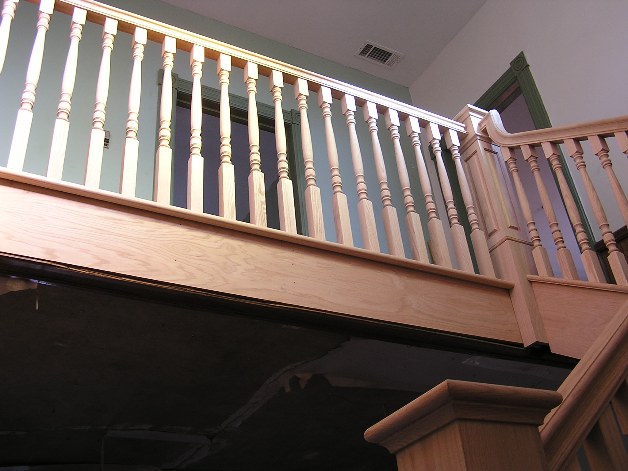 Top rail on second floor made out of Oak